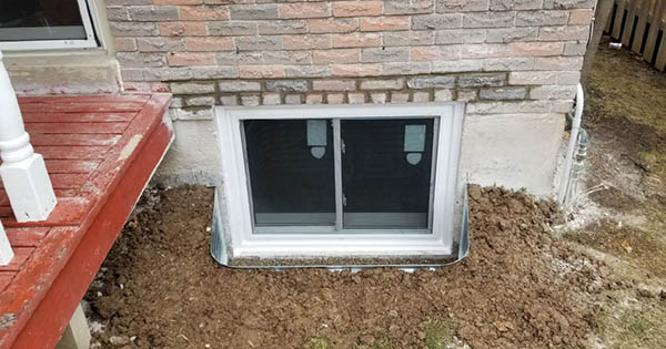 Egress window installation with window well in Brampton after